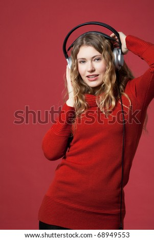 young woman listening to music and moves to - stock photo