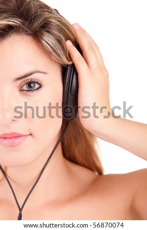Young woman listening to music -  isolated