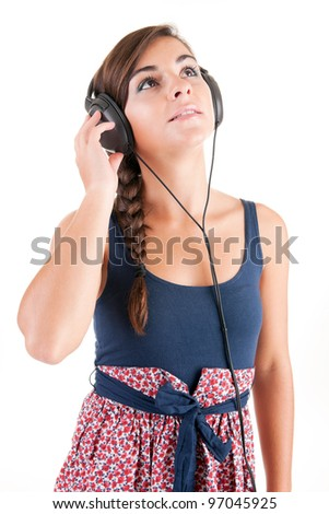 Young woman listening to music, isolated over white background - stock photo