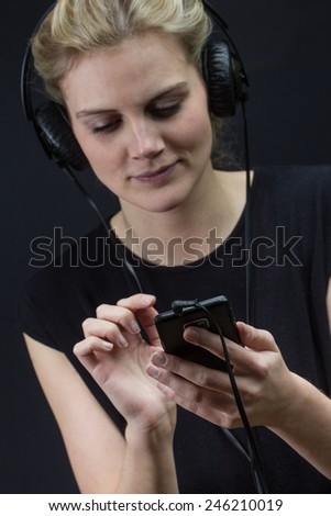 young woman listening to music with a smartphone