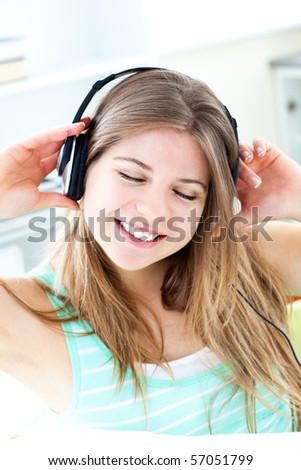 Young woman listening to music with headphones on