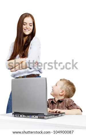 Young woman, little boy, emotion and laptop. The staging..