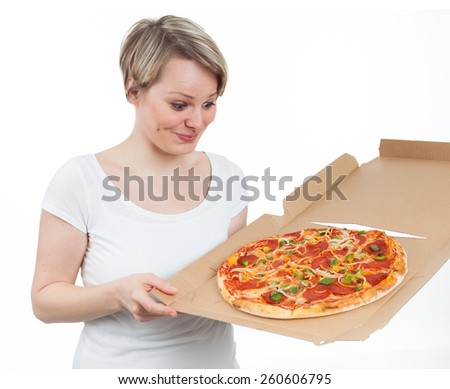 Young woman looking at a pizza with appetite, isolated on white - stock photo