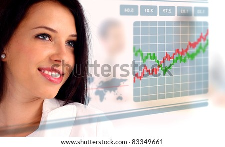 Young woman looking at a stock chart - stock photo