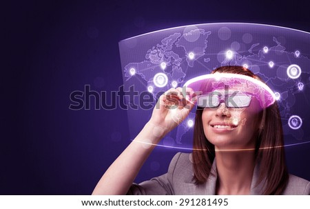 Young woman looking at futuristic social network map concept - stock photo