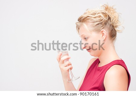 Young woman looking at glass.