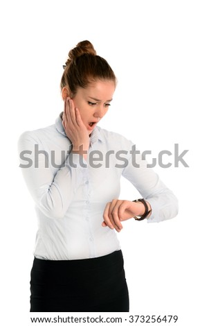 Young woman looking at her watch being late, Isolated on white background - stock photo