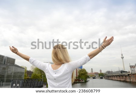 Young woman looking at Spree river, Berlin TV Tower, Germany - stock photo