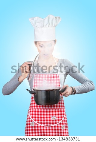 Young woman looking at steam escaping from the pot; on blue background - stock photo