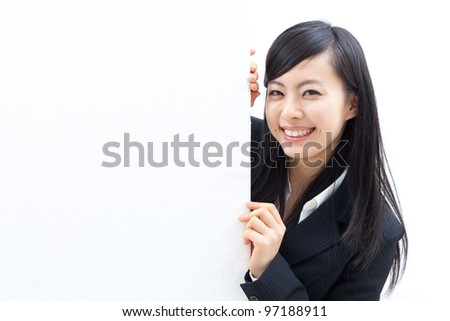 young woman looking at the blank billboard - stock photo