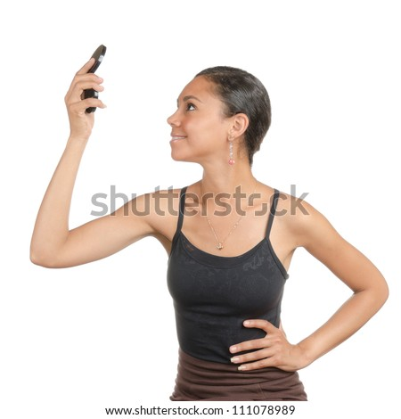 Young woman looking at the hand held, make-up  mirror with different facial expressions. Body language. Happy, surprised, open. Isolated on white . - stock photo