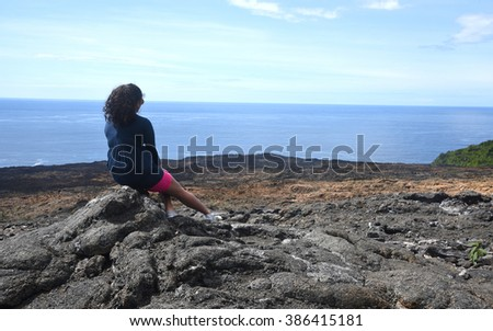 Young woman looking at the horizon on reunion island