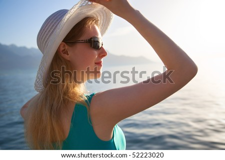 Young woman looking at the shore portrait.