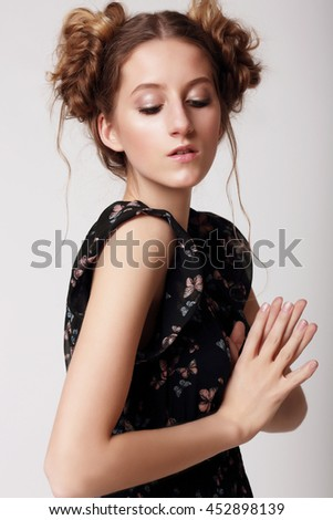Young woman looking down. Teenager, lifestyle. Funny, cute. - stock photo