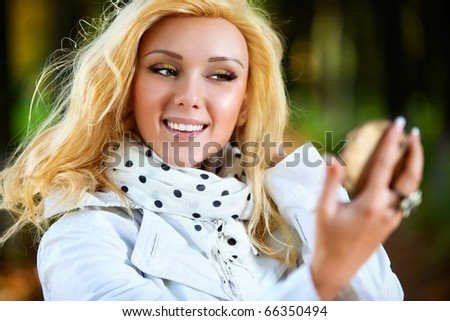 Young woman looking on mirror. Focus on face. - stock photo