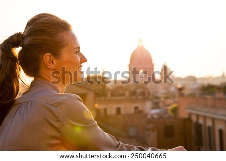 Young woman looking on rome panorama on sunset - stock photo