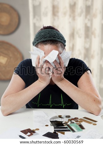 Young woman looking overwhelmed by her financial situation. - stock photo