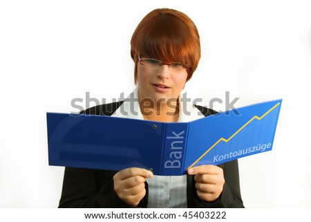 Young woman looking shocked at statement of account. - stock photo