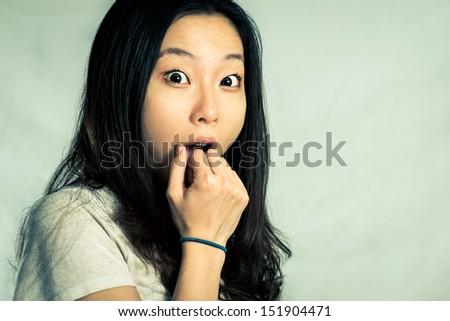 Young woman looking surprised, with fashion tone. - stock photo