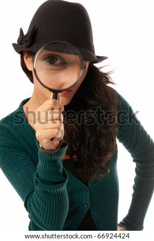 Young woman looking through magnifying glass loupe detective isolated on white background - stock photo