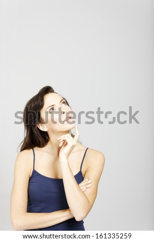 Young woman looking to her left expressing an idea or thought.