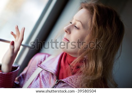 Young woman looking to the train window portrait.