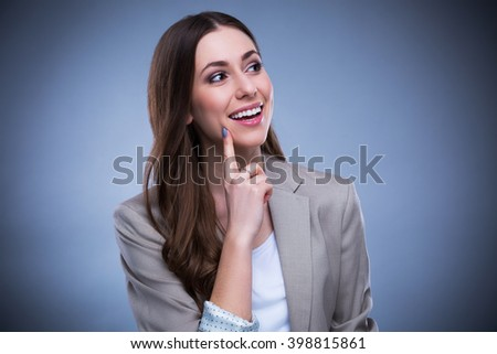 Young woman looking up  - stock photo