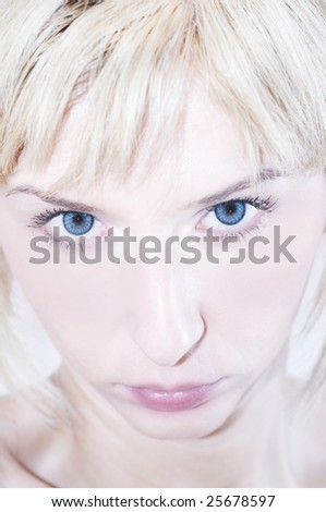 Young woman looking up - bright image