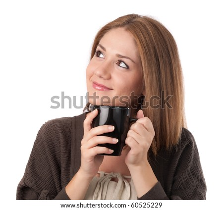 Young woman looking up holding a cup,isolated on white