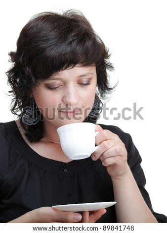 Young woman looking up holding a cup, isolated on white