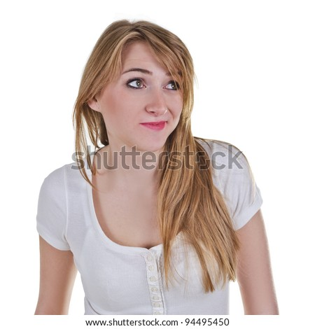 Young woman looking up-left with expression as she is disappointed about something - stock photo