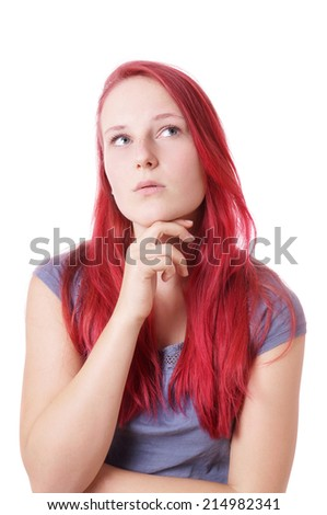 young woman looking up thinking - stock photo