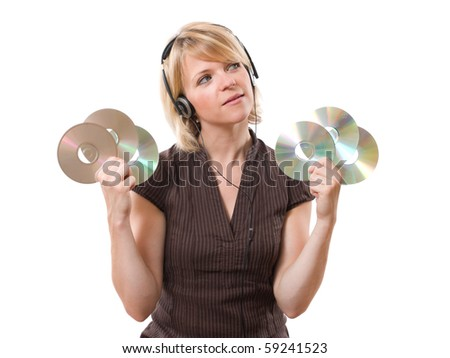 young woman looking up with cds in the hands - stock photo