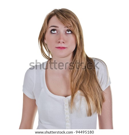 Young woman looking up with expression as she is thinking about something - stock photo