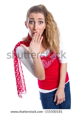 Young woman looks shocked - stock photo