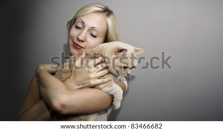 Young Woman loves her cute Cat - stock photo