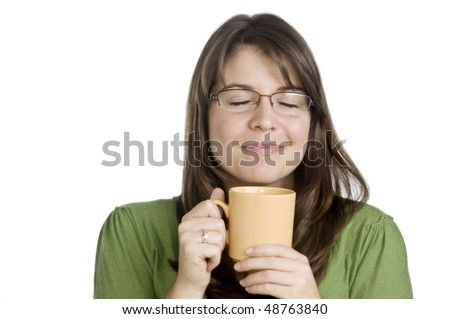 young woman loving her morning cup of coffee, white background - stock photo
