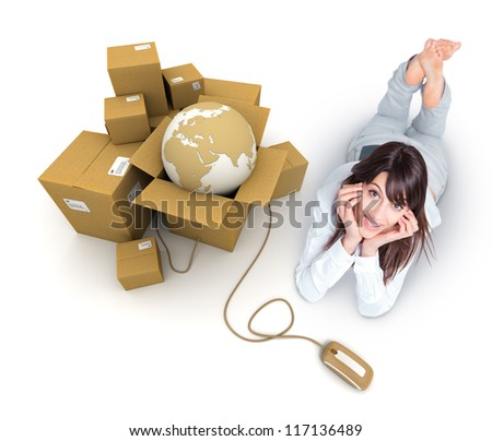 Young woman lying by a pile of parcels containing the Earth connected to a computer mouse - stock photo