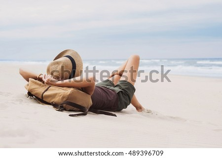 Young woman lying on a beach. Relaxation concept