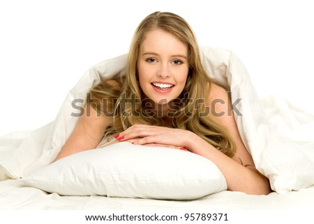 Young woman lying on bed - stock photo