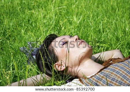 Young woman lying on the grass in the park