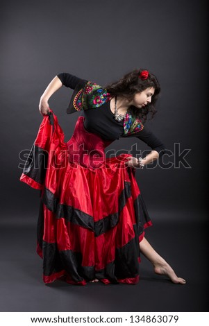 Young woman make step in spanish traditional clothes