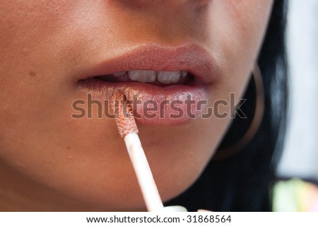 Young woman makes a makeup - stock photo