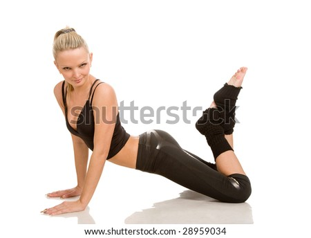 young woman makes exercises on a white background