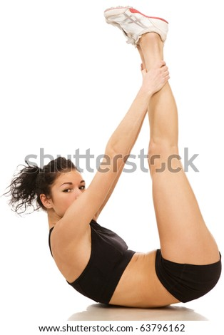 young woman makes exercises on a white background - stock photo
