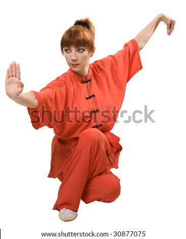 young woman makes kung-fu exercise isolated with clipping path on white background - stock photo