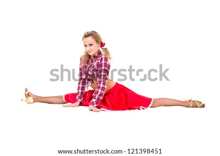 young woman makes splits against isolated white background - stock photo