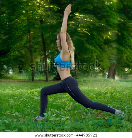 young woman makes stretching in the park