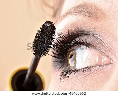 Young woman makeup with mascara eye closeup - stock photo
