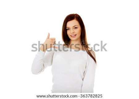 Young woman making a call me gesture - stock photo